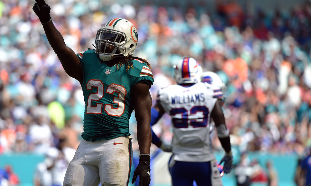 Oct 23, 2016; Miami Gardens, FL, USA; Miami Dolphins running back Jay Ajayi (23) singles for a first down during the first half against the Buffalo Bills at Hard Rock Stadium. Mandatory Credit: Steve Mitchell-USA TODAY Sports